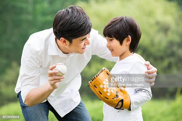 Father teaching son how to play baseball