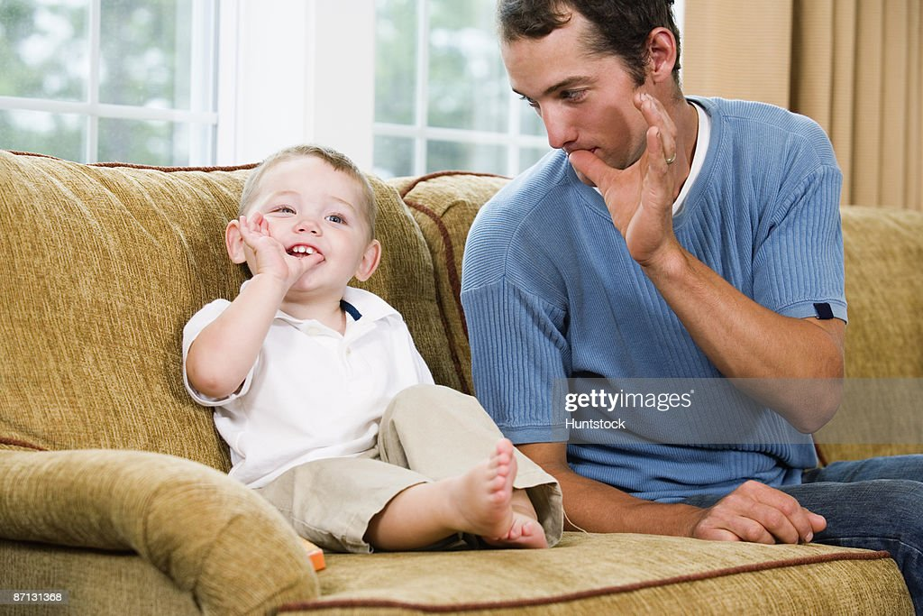 Father teaching son sign language