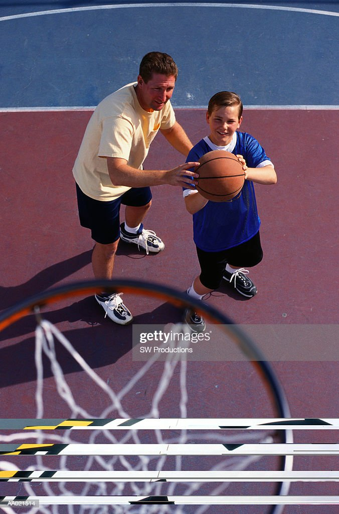 Father Teaching Son to Play Basketball : Stock Photo