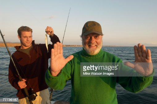Father Telling Fish Story : Stock Photo