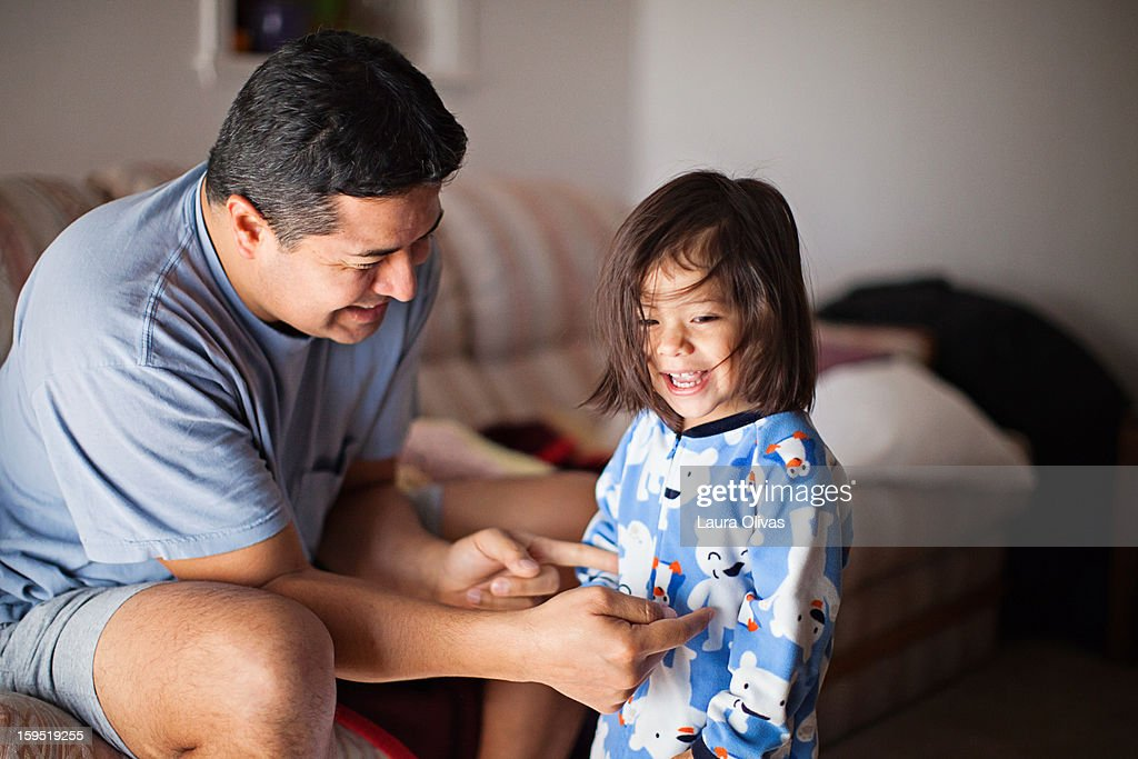 Father Tickles Toddler Daughter : Stock Photo