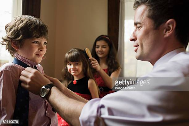 A father tying his sons tie