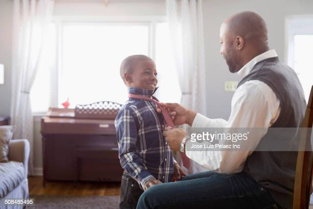 Father tying son's tie