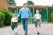 Father walking children to school