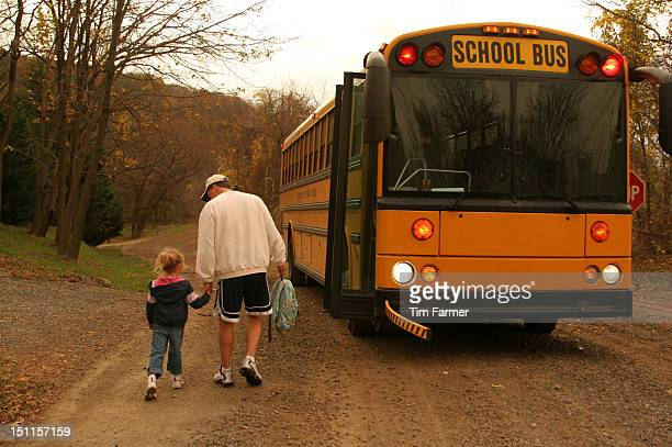 Father Walks Daughter to Yellow School Bus