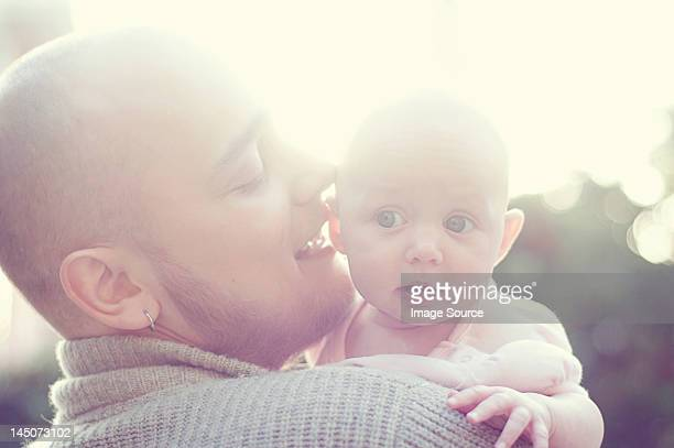 Father whispering to baby