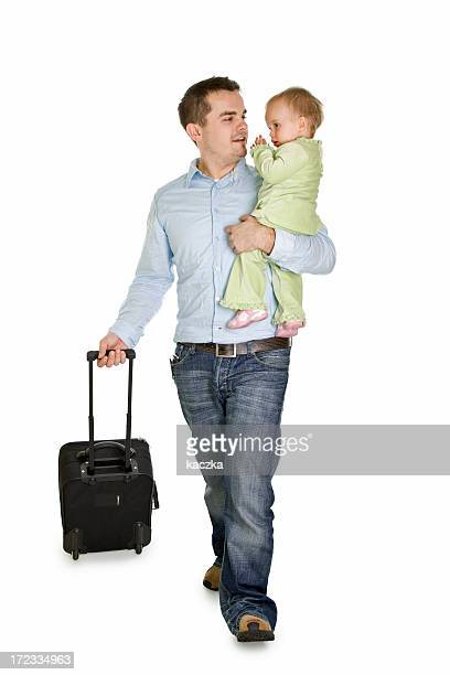 Father with a baby at the airport isolated on white
