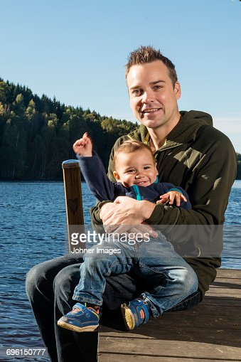 Father with baby boy on jetty
