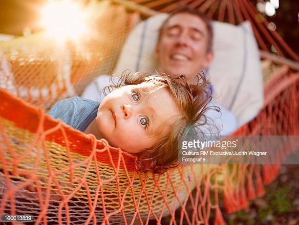 Father with baby daughter in hammock