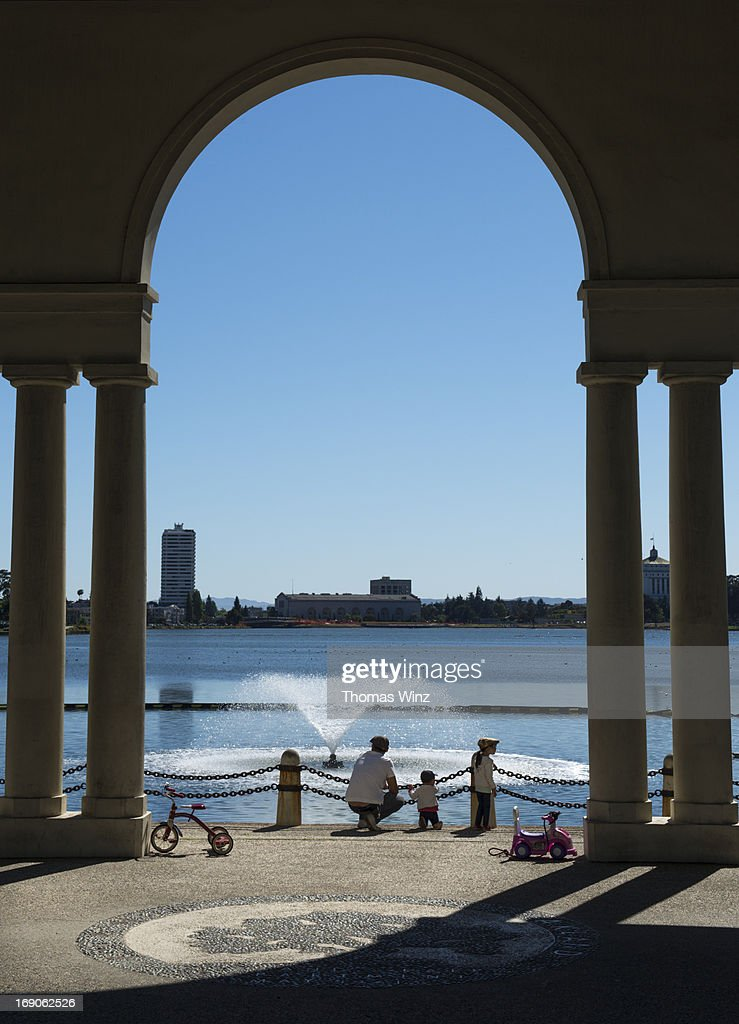 Father with children at Lake Merritt