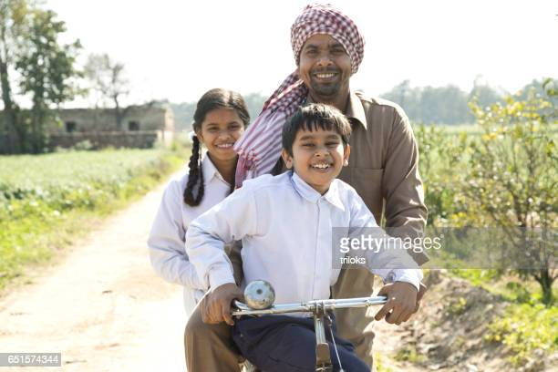 Father with children riding on bicycle