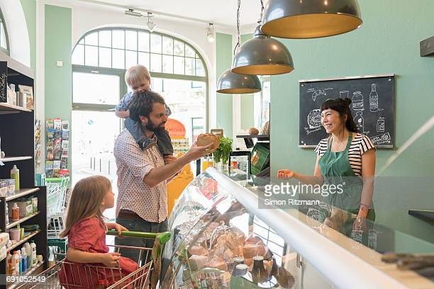 Father with daughter and son at deli counter