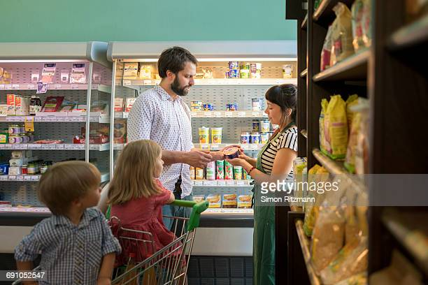 Father with daughter and son in grocery store