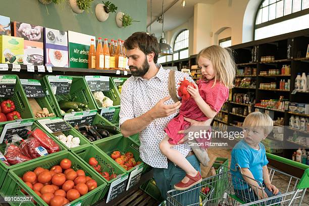 Father with daughter and son shopping organic food