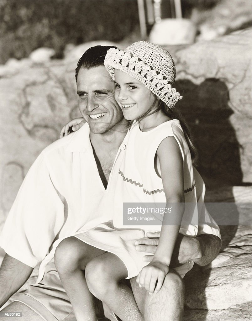 Father with daughter (5-7) at beach, (B&W) : Stock Photo