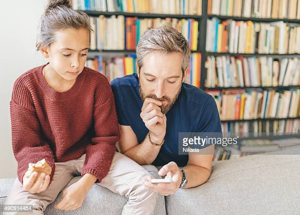 father with daughter at home
