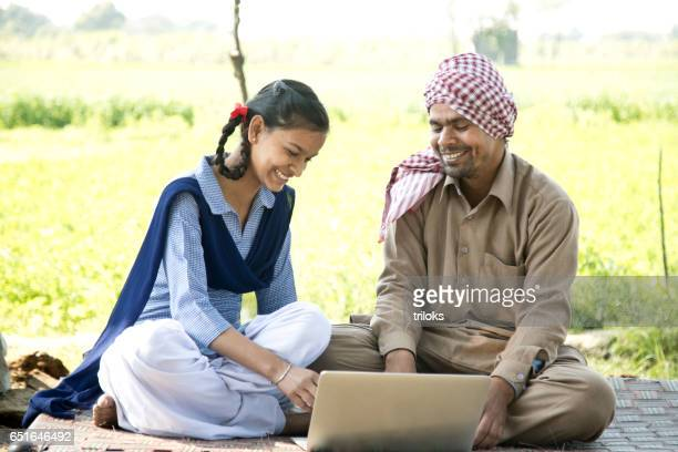 Father with daughter using laptop
