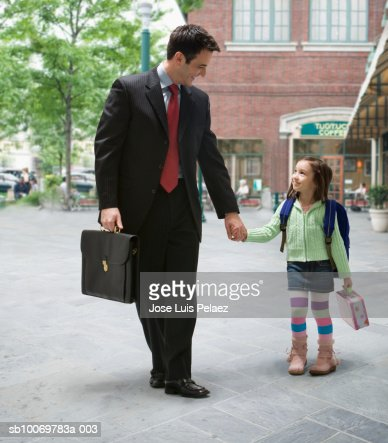 Father with daughter (4-5) walking to school : Stock Photo