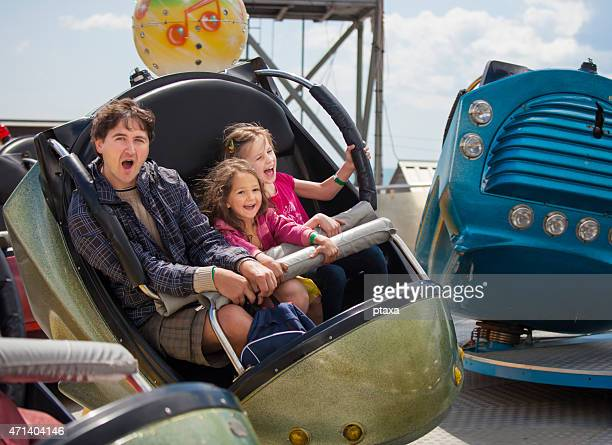 Father with daughters in the amusement park
