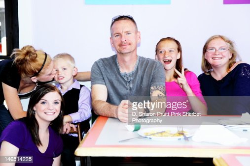 Father with five children at table : Stock Photo