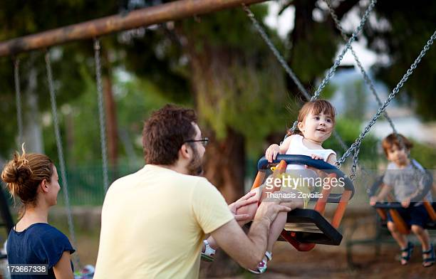 Father with his daughter in a playground