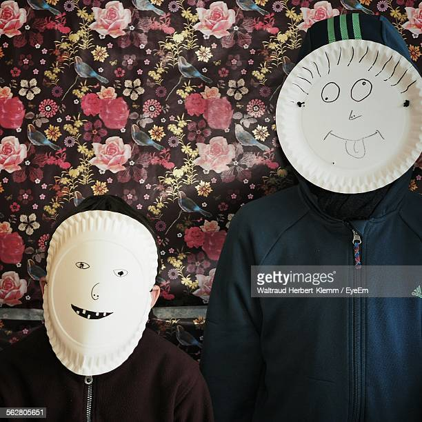 Father With His Son Making Face Masks
