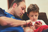 Father with his son using a smartphone