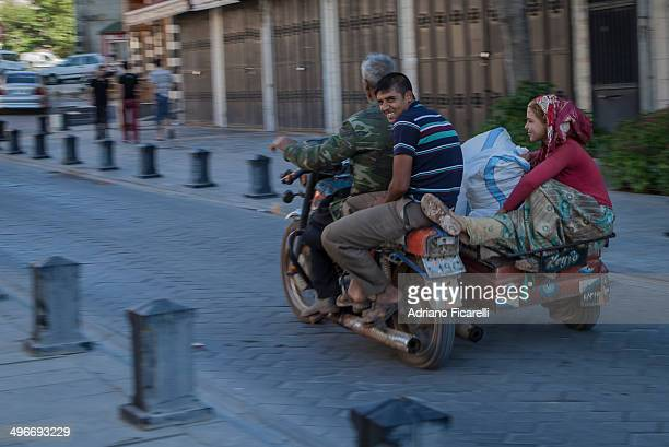 CONTENT] A father with his sons carry their goods to the local market