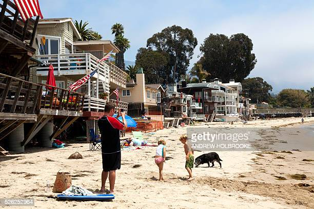 A father with his two children takes photographs on Miramar Beach Montecito on the Pacific Ocean is a wealthy beach community along California's...