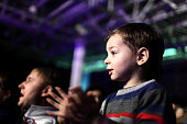 Father with his son applauding at a concert