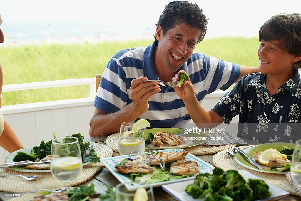 Father with son (10-11) at lunch outside : Stock Photo