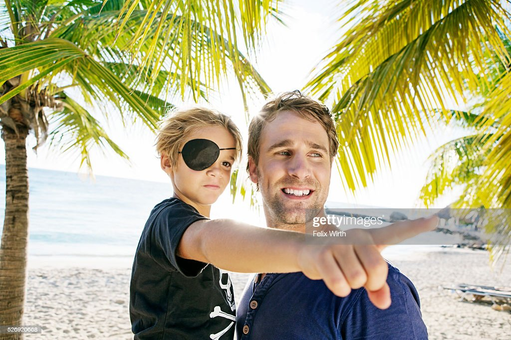 Father with son (8-9) dressed as pirate : Stock Photo