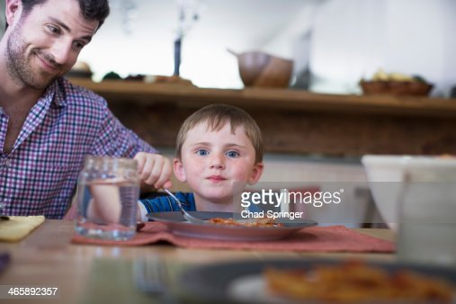 Father with son eating dinner
