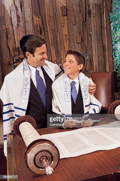 Father with son in temple during bar mitzvah ceremony