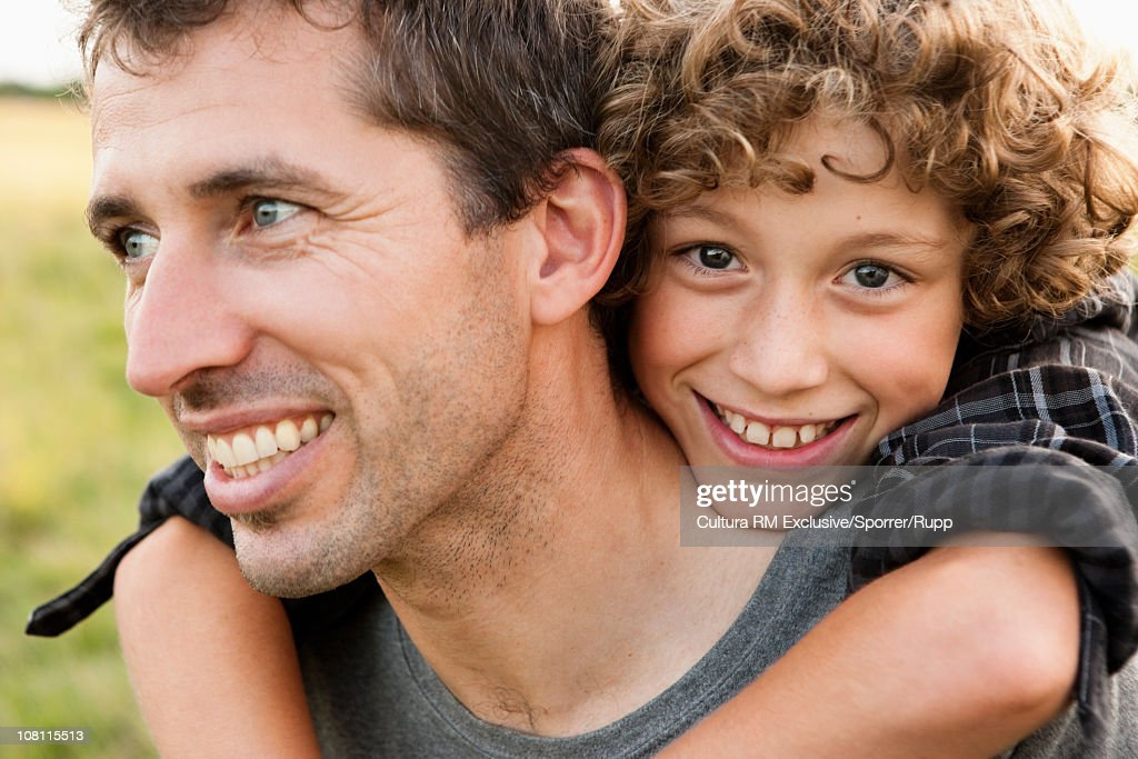 Father with son on his shoulders : Stock Photo