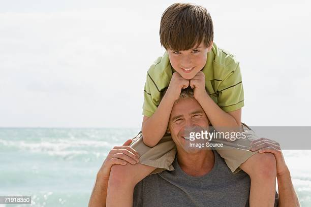 Father with son on shoulders