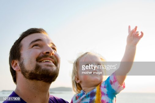 Father with toddler exploring nature : Stock Photo