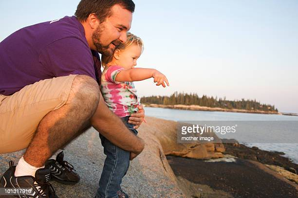 Father with toddler exploring nature