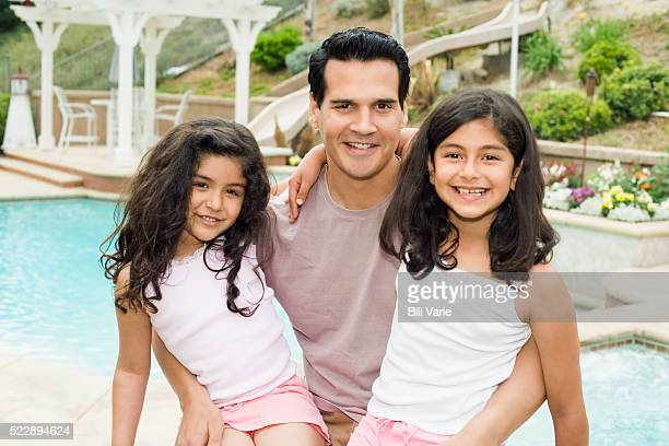 Father with two daughters on his lap
