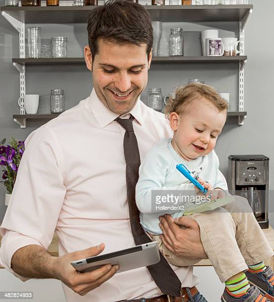 Father working while with son