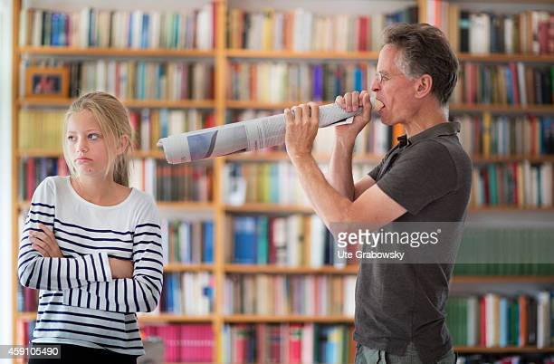Father yelling at his teenaged daughter through a megaphone made out of rolledup newspapers on August 12 in Duelmen Germany Photo by Ute...
