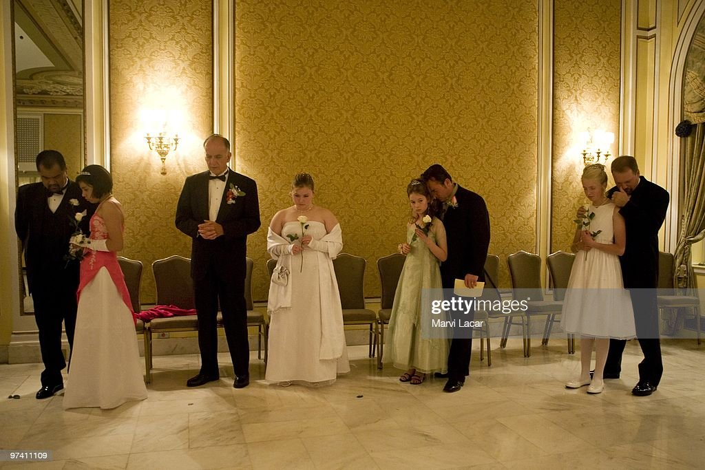 Fathers and daughters pray together in the ballroom of the Broadmoor Hotel on May 16, 2008 in Colorado Springs, Colorado. The annual Father-Daughter Purity Ball, founded in 1998 by Randy and Lisa Wilson, focuses on the idea that a trustworthy and nurturing father will influence his daughter to lead a lifestyle of 'integrity and purity.'