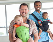 Fathers carrying kids (6-12 months) in baby carriers