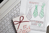 Fathers Day gift box and children's coloring with ties on notebook