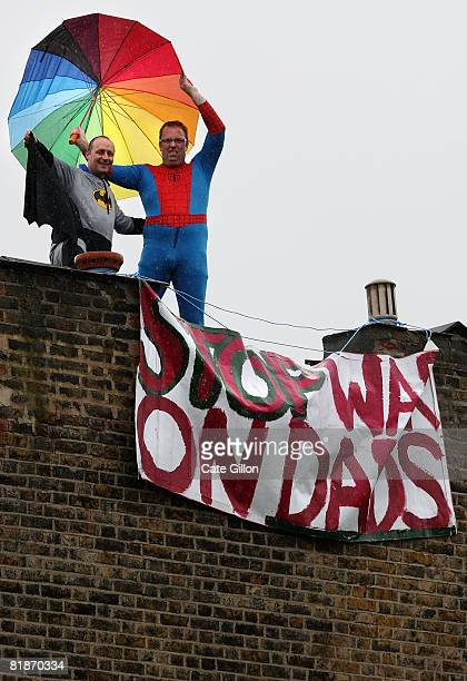 Fathers for Justice campaigners dressed as Spiderman and Batman protest on the roof of Deputy Labour leader Harriet Harman's home on July 9 2008 in...