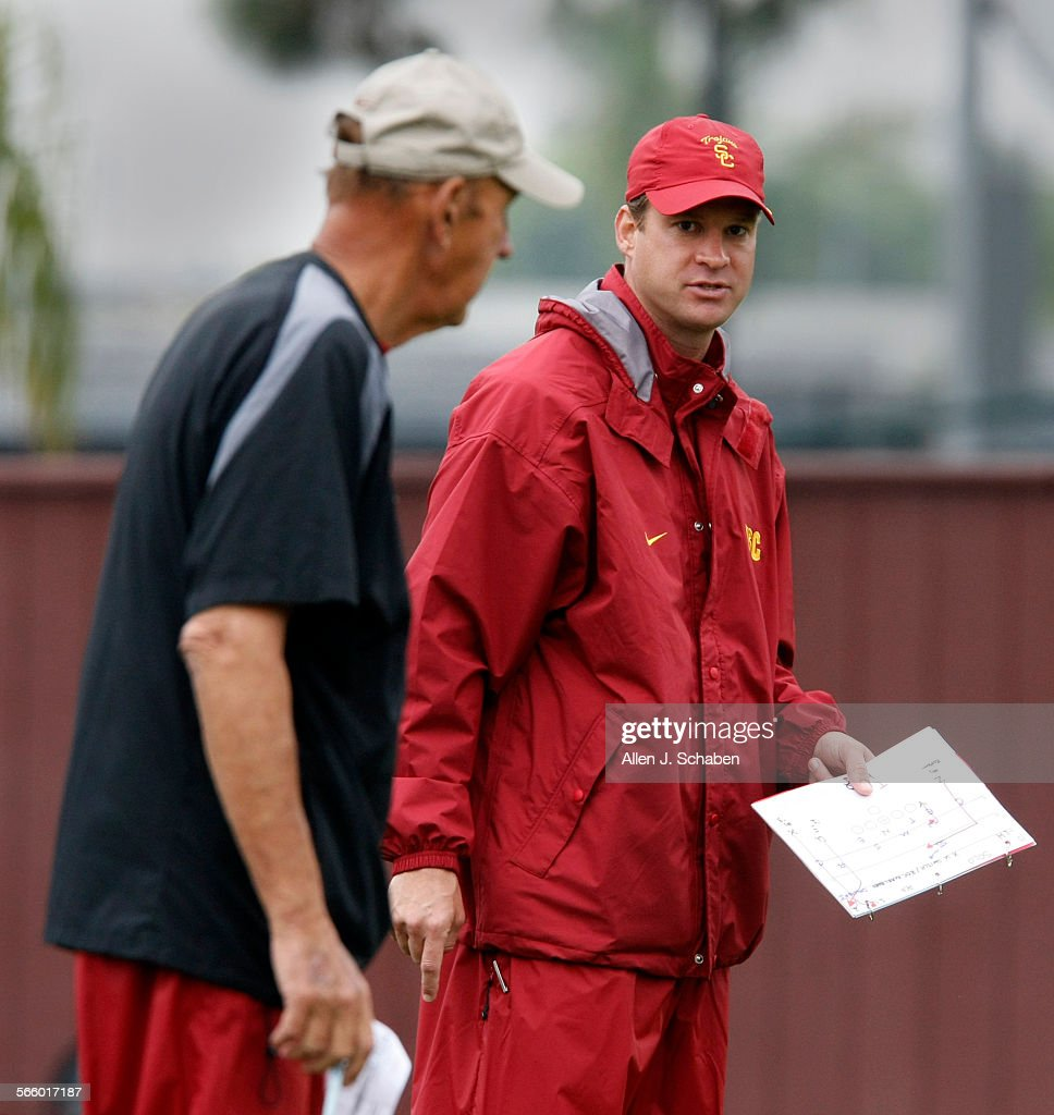 Monte Kiffin left USC football defensive coordinator and his son Lane Kiffin head coach work with the team during practice at USC This is an...
