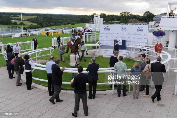 Fathsta ridden by Jockey Jamie Spencer is lead into the winner's enclosure after winning the Download Epsom's Android Or Iphone App Now Claiming...