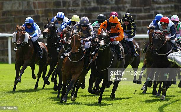 Fathsta ridden by Stephen Donohoe and Celtic Sultan ridden by Micky Fenton lead in to the final bend during the SurrendaLink Earl Grosvenor Stakes...
