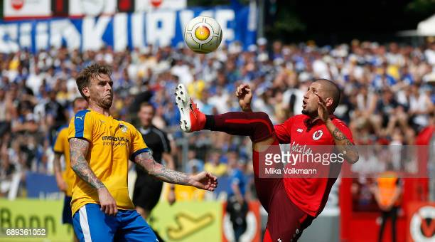 Fatih Candan of Viktoria Koeln fights for the ball against Rene Klingbeil of Jena during the Third League Plaffoff match between Viktoria Koeln and...