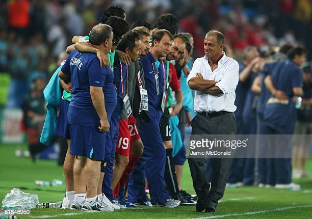 Fatih Terim coach of Turkey walks past his coaching staff during the UEFA EURO 2008 Quarter Final match between Croatia and Turkey at Ernst Happel...